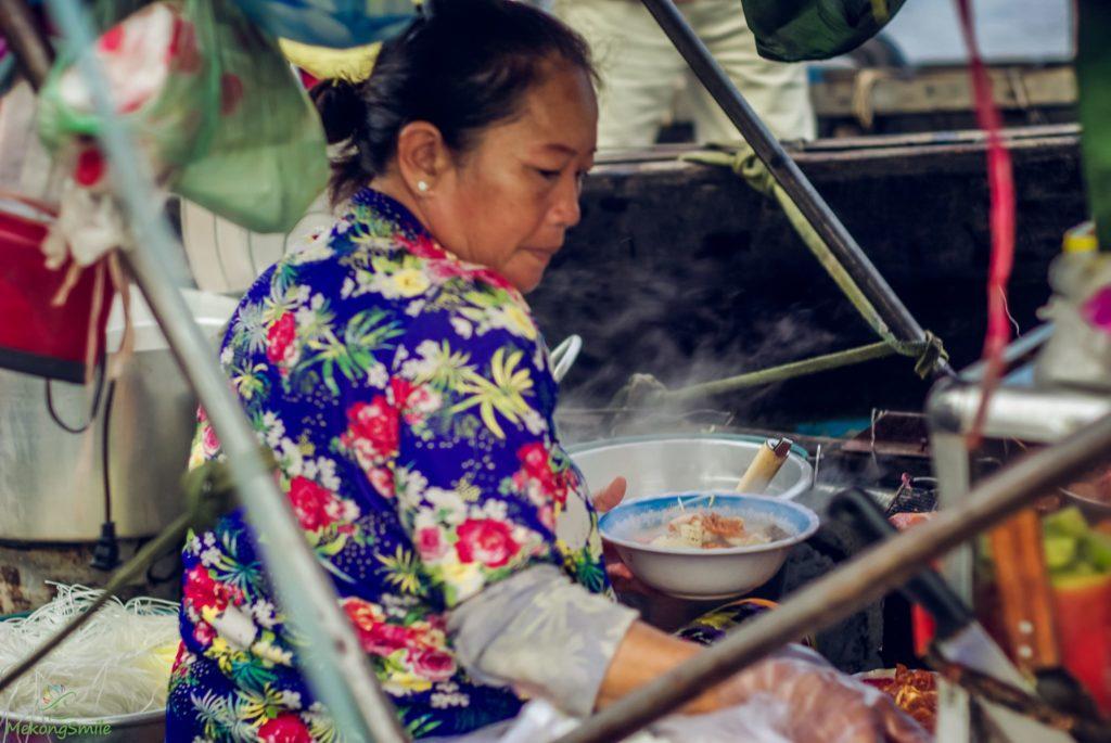 Lady selling Bun rieu