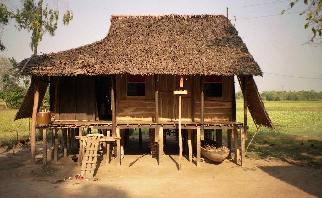 Wood house with palm thatched roof in Mekong Delta, Vietnam