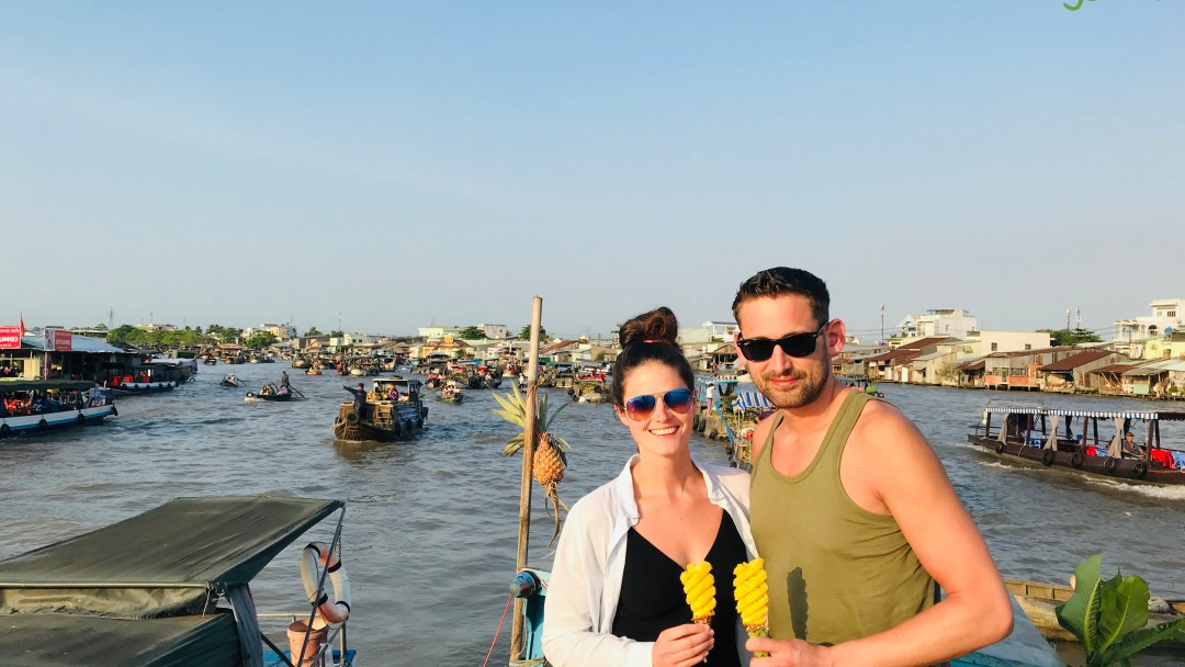 Enjoy fresh pineapple in Cai Rang floating market - Can Tho cycling tour