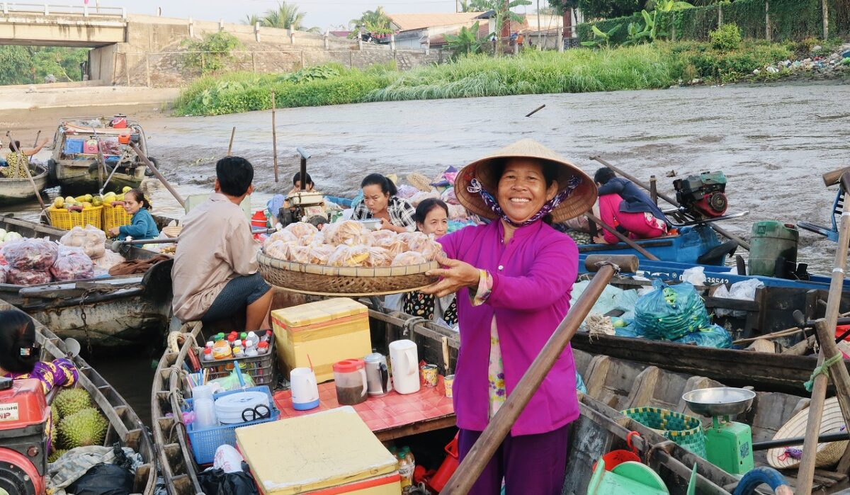 Happy saleswoman in the Mekong floating market