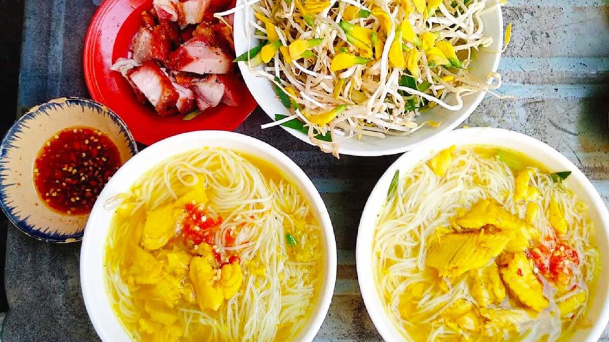 Snakehead fish rice noodles served with roasted pork and sesban flowers