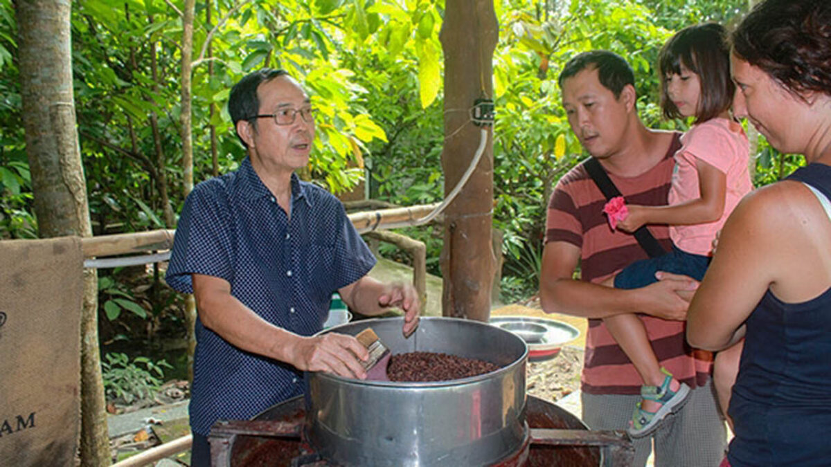 Grinding cocoa beans into chocolate paste